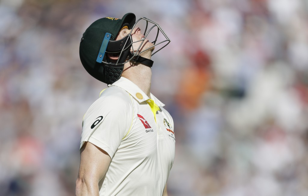 Australia's Steve Smith leaves the pitch after he is caught by England's Ben Stokes off the bowlng of England's Stuart Broad during the fourth day of ...