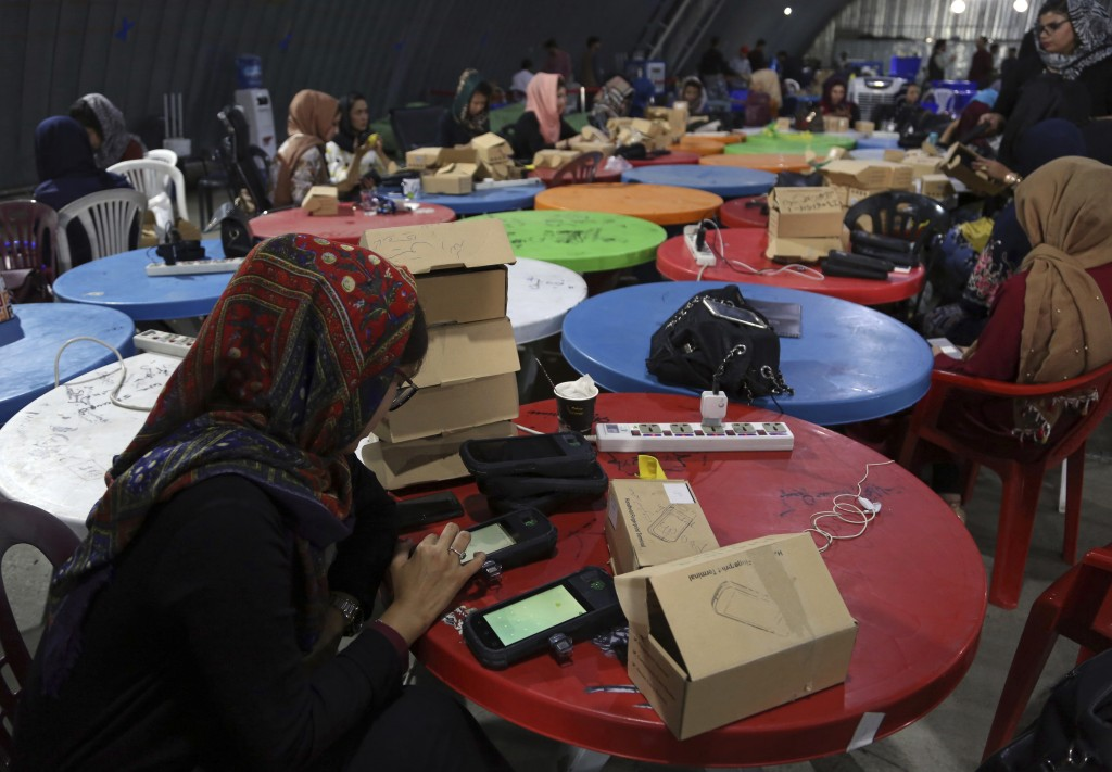 Election commission workers check biometric devices in preparation for the presidential election scheduled for Sept 28, at the Independent Election Co...
