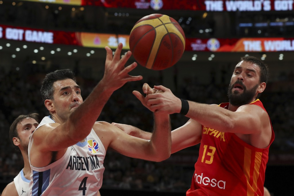 Luis Scola of Argentina and Marc Gasol of Spain battle the ball during their FIBA Basketball World Cup Final, at the Cadillac Arena in Beijing, Sunday