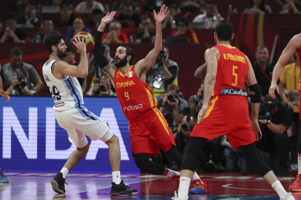 Patricio Garino of Argentina is tackled by Ricky Rubio of Spain during their FIBA Basketball World Cup Final, at the Cadillac Arena in Beijing, Sunday