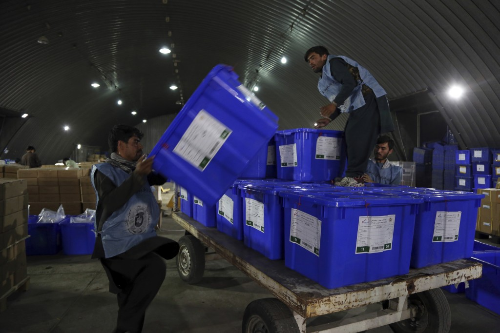 Election commission workers move ballot boxes in preparation for the presidential election scheduled for Sept 28, at the Independent Election Commissi...