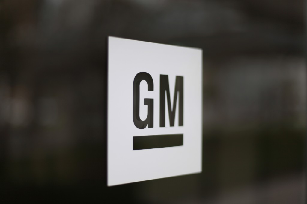 FILE - This file photo from May 16, 2014 shows the General Motors logo at the company's headquarters in Detroit. The United Auto Workers union consists of