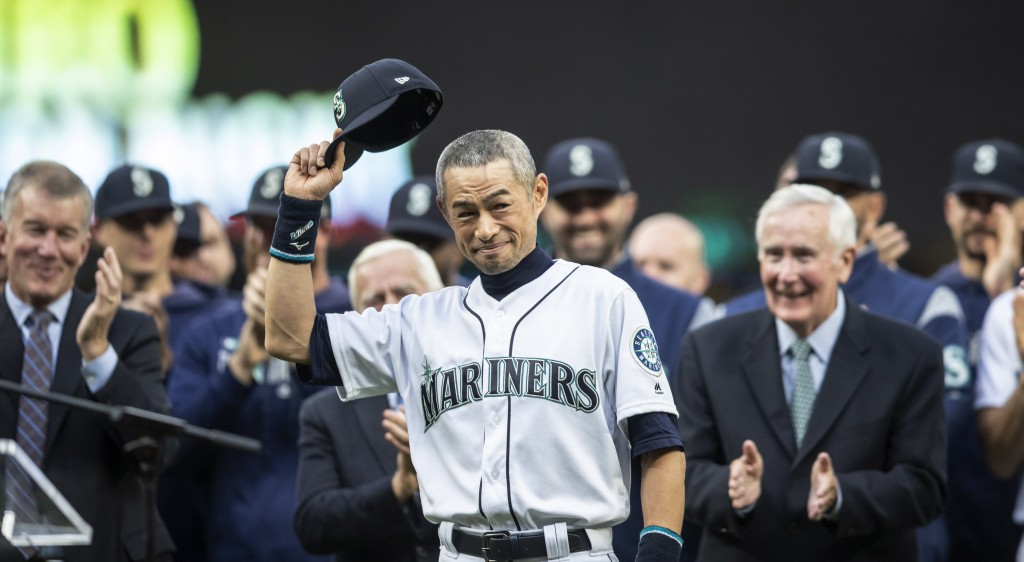 Former Seattle Mariners player Ichiro Suzuki acknowledges the crowd during a ceremony in which he was presented wit the team's Franchise Achievement A...