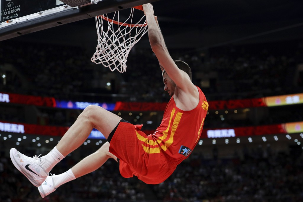 Juancho Hernangomez of Spain dunks the ball against Argentina during their FIBA Basketball World Cup Final, at the Cadillac Arena in Beijing, Sunday, ...