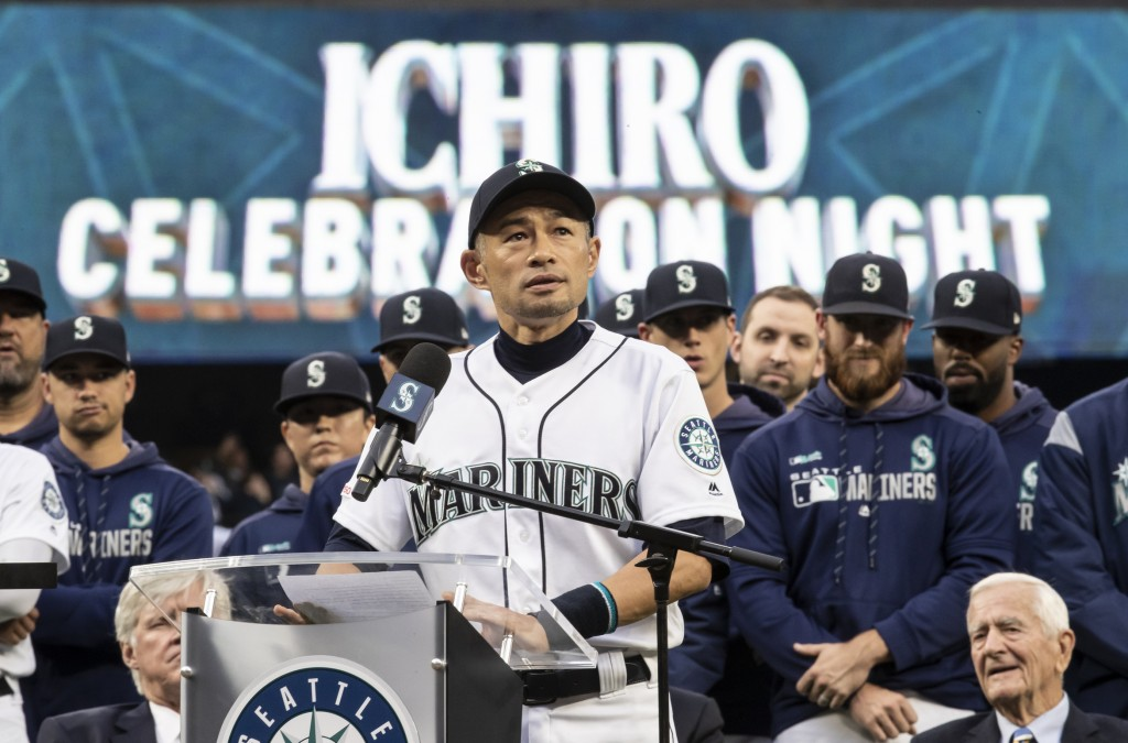 Former Seattle Mariners player Ichiro Suzuki pauses while giving a speech during a ceremony in which he was given Mariners' Franchise Achievement Awar