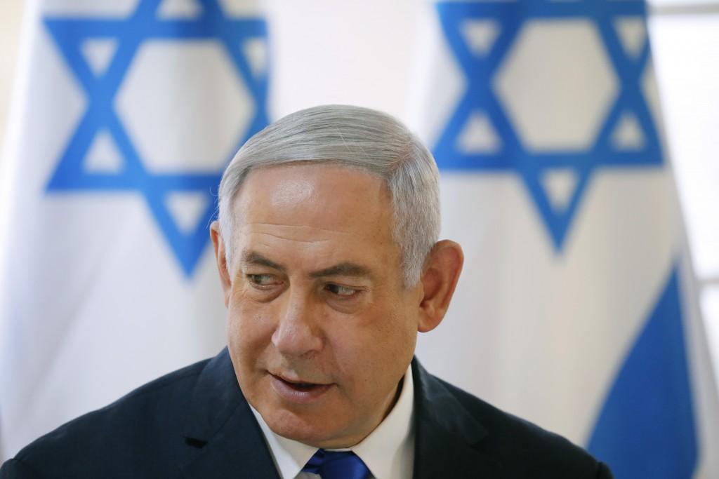 Israeli Prime Minister Benjamin Netanyahu chairs during the weekly cabinet meeting being held in the Jordan Valley, in the Israeli-occupied West Bank,