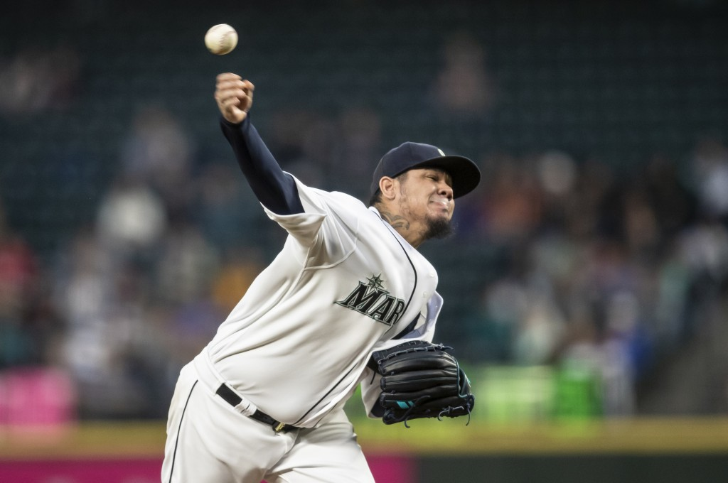 Seattle Mariners starter Felix Hernandez delivers a pitch during the fourth inning of the team's baseball game against the Chicago White Sox, Saturday