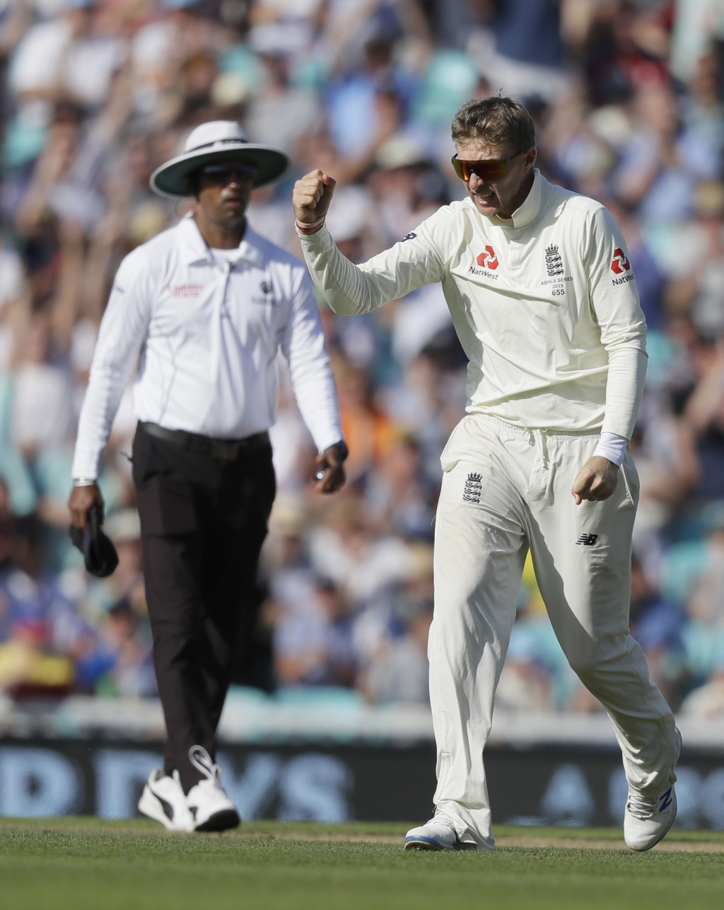 England's Joe Root celebrates taking the wicket of Australia's Mitchell Marsh during the fourth day of the fifth Ashes test match between England and ...