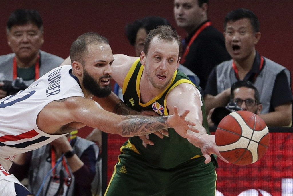 Joe Ingles of Australia and Evan Fournier of France battle the ball during their third placing match for the FIBA Basketball World Cup at the Cadillac