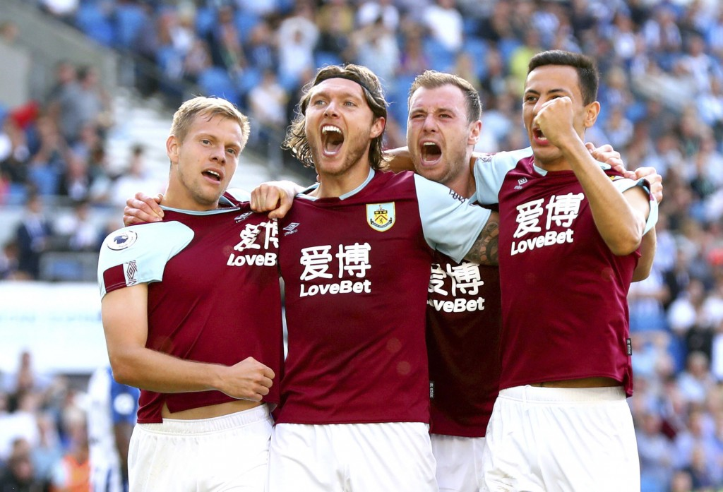 Burnley's Jeff Hendrick, second left, celebrates scoring his side's first goal of the game during their English Premier League soccer match against Br...