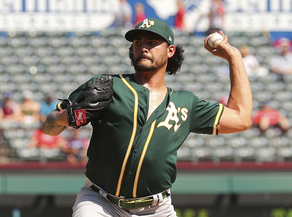 Oakland Athletics starting pitcher Sean Manaea (55) throws against the Texas Rangers in the fourth inning of a baseball game Sunday, Sept. 15, 2019, i