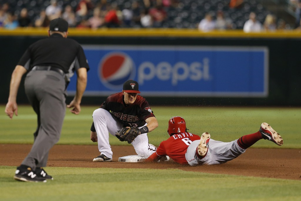Cincinnati Reds' Phillip Ervin (6) is tagged out by Arizona Diamondbacks shortstop Nick Ahmed while trying to steal second base in the seventh inning ...