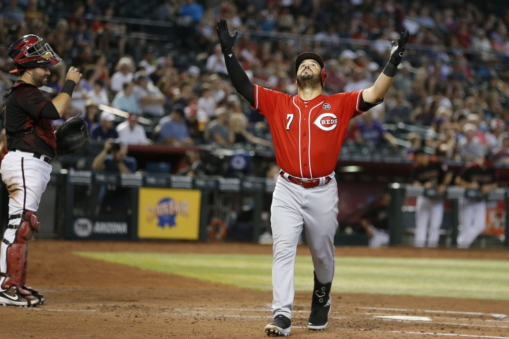 Cincinnati Reds' Eugenio Suarez celebrates after hitting a solo home run against the Arizona Diamondbacks in the fourth inning during a baseball game,...