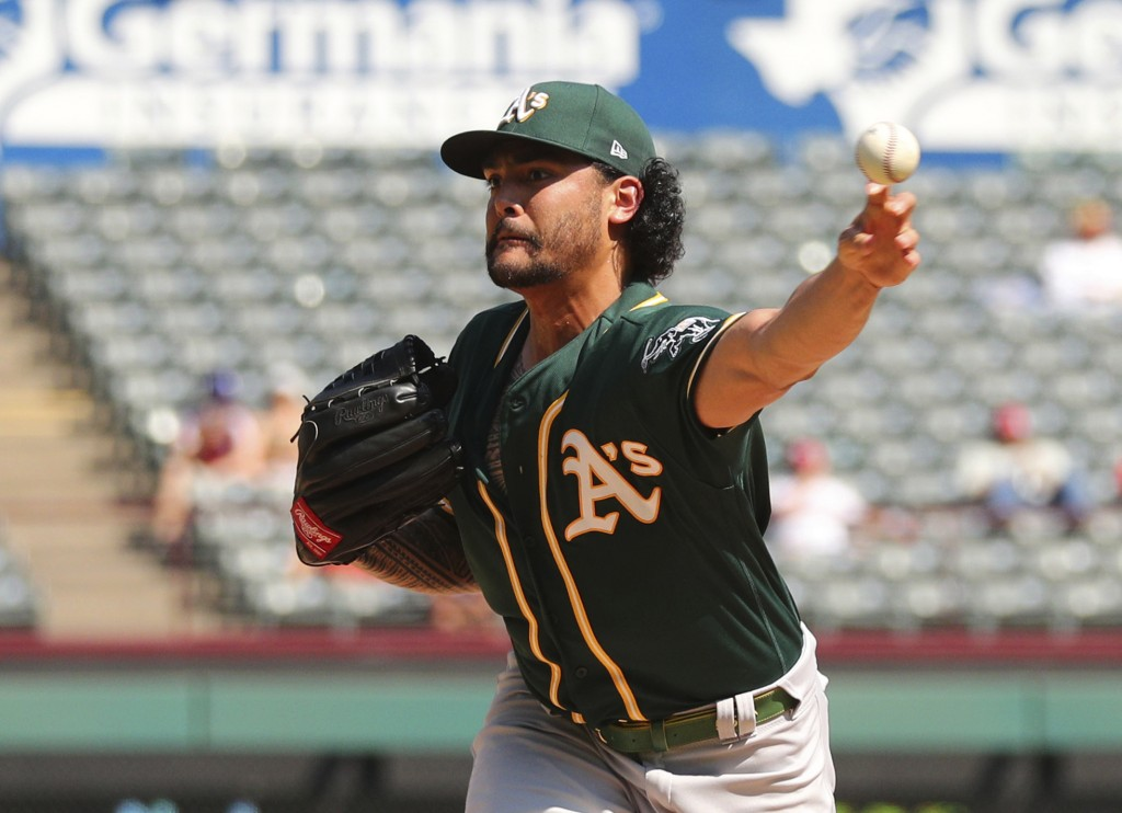 Oakland Athletics starting pitcher Sean Manaea throws against the Texas Rangers in the fourth inning of a baseball game Sunday, Sept. 15, 2019, in Arl