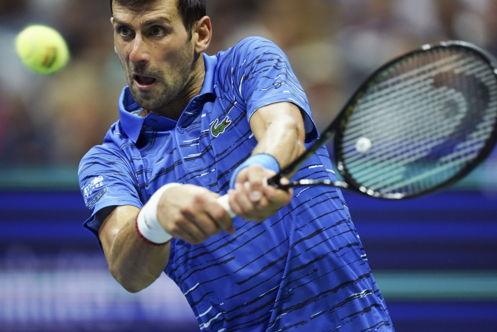 Novak Djokovic, of Serbia, returns to Stan Wawrinka, of Switzerland, during the U.S. Open tennis championships, Sunday, Sept. 1, 2019, in New York. (A