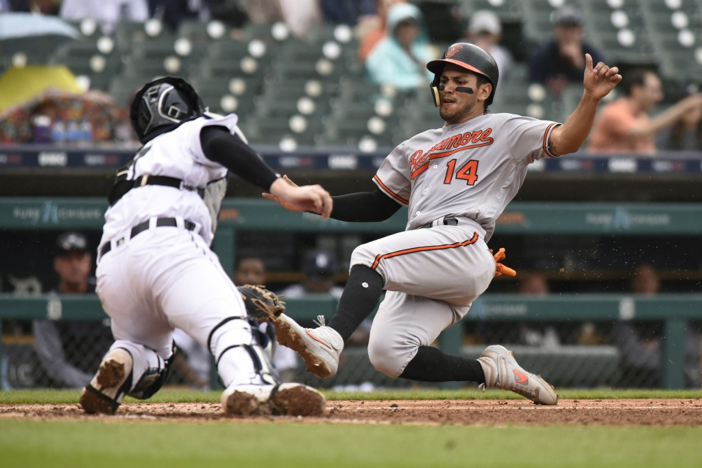 Detroit Tigers catcher Grayson Greiner, left, tags out Baltimore Orioles' Rio Ruiz at home plate in the sixth inning of a baseball game Sunday, Sept. ...