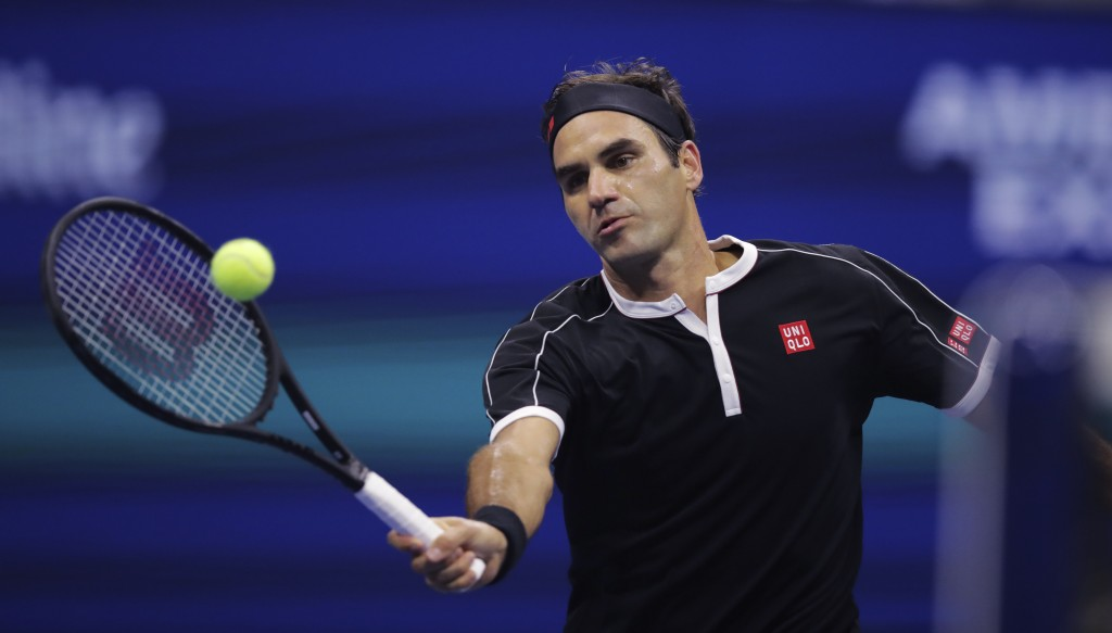 Roger Federer, of Switzerland, returns to Grigor Dimitrov, of Bulgaria, during the quarterfinals of the U.S. Open tennis tournament Tuesday, Sept. 3, ...