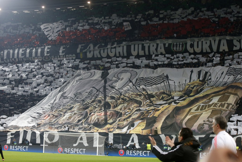 FILE - In this Feb. 23, 2016 file photo, Juventus fans unveil a giant banner prior to the Champions League, round of 16, first-leg soccer match betwee...