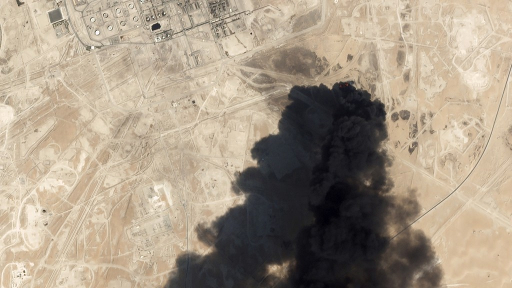 FILE - This Saturday, Sept. 14, 2019, satellite image from Planet Labs Inc., shows thick black smoke rising from Saudi Aramco's Abqaiq oil processing ...