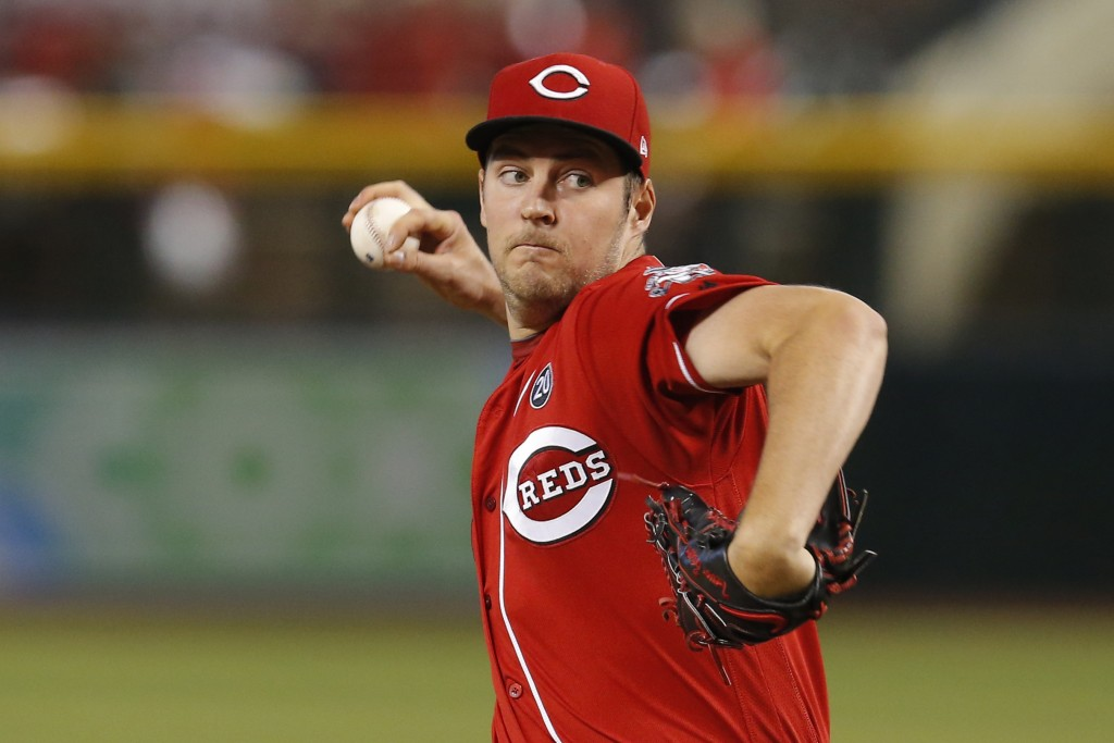 Cincinnati Reds pitcher Trevor Bauer throws against the Arizona Diamondbacks in the first inning during a baseball game, Sunday, Sept. 15, 2019, in Ph...