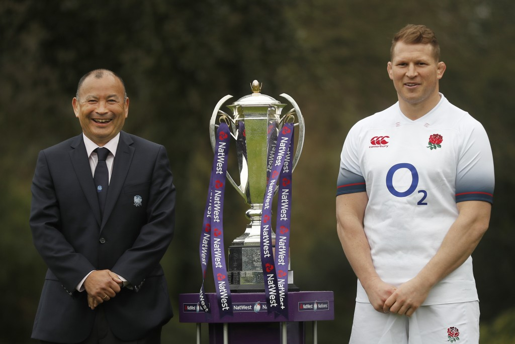 FILE- In this Jan. 24, 2018 file photo, Six Nations England rugby team coach Eddie Jones and captain Dylan Hartley, right, pose for photographers with