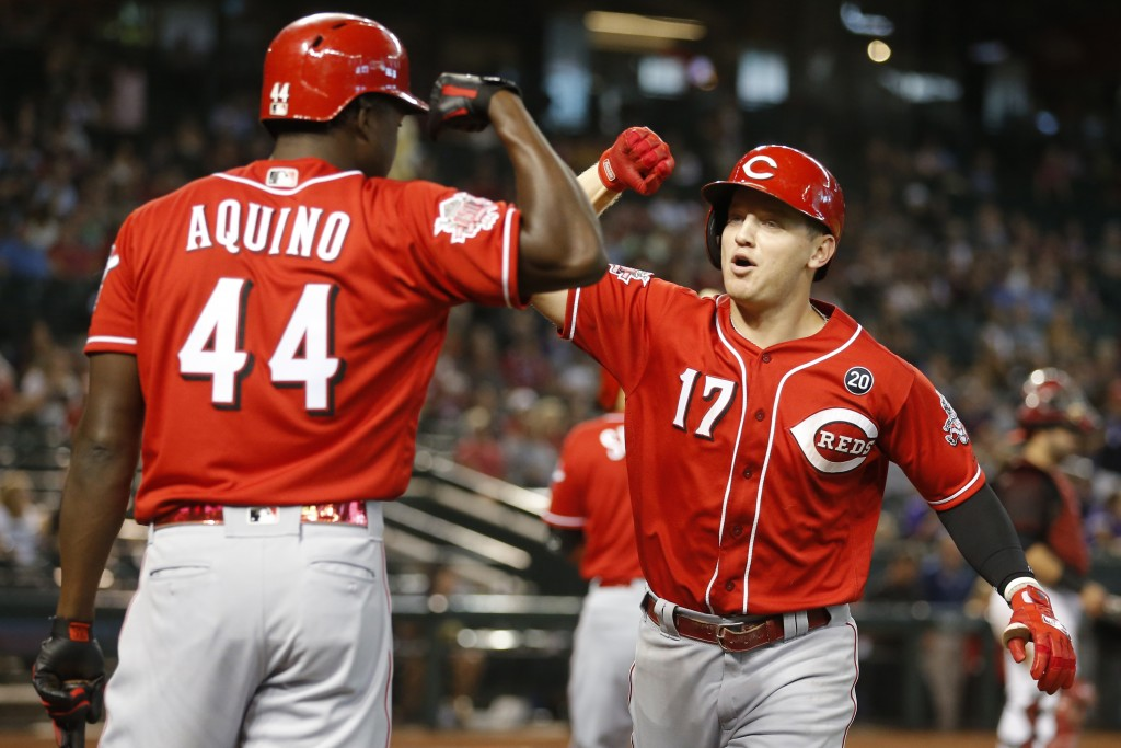 Cincinnati Reds' Josh VanMeter (17) celebrates with Aristides Aquino after hitting a solo home run against the Arizona Diamondbacks in the fourth inni