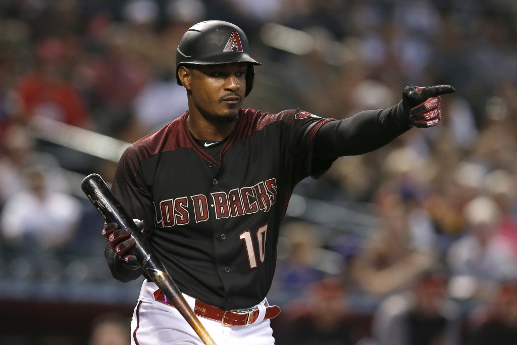 Arizona Diamondbacks' Adam Jones reacts after a called strike in the second inning during a baseball game against the Cincinnati Reds, Sunday, Sept. 1...