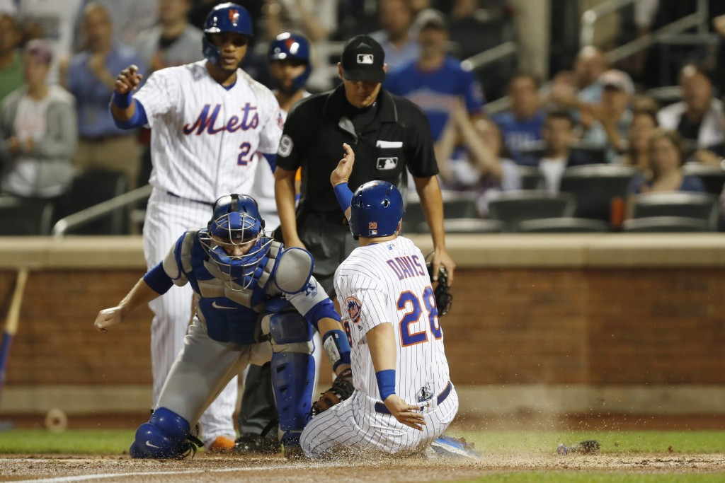 Los Angeles Dodgers catcher Will Smith, beflow left, applies a late tag on New York Mets' J.D. Davis, (28) who scores on Brandon Nimmo's two-run tripl...