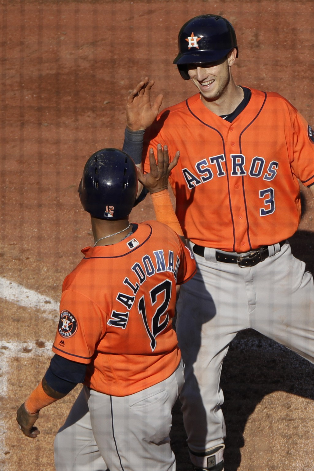 Houston Astros' Kyle Tucker (3) celebrates with Martin Maldonado (12) after hitting a two-run home run during the eighth inning of a baseball game aga...