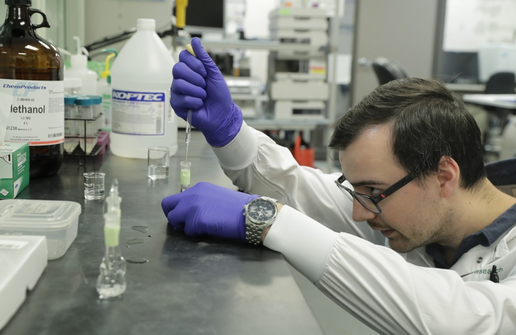 Pierce Prozy prepares a CBD vape oil test sample at Flora Research Laboratories in Grants Pass, Ore., on July 19, 2019. The Associated Press commissio...