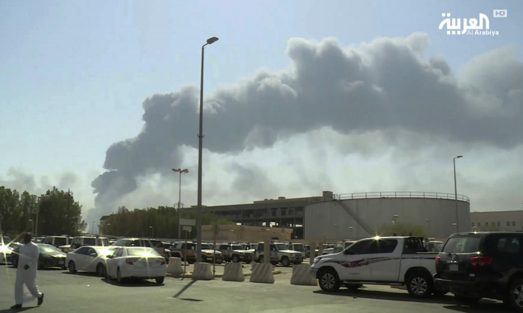 FILE - In this Saturday, Sept. 14, 2019 file photo, made from a video broadcast on the Saudi-owned Al-Arabiya satellite news channel, smoke from a fir...