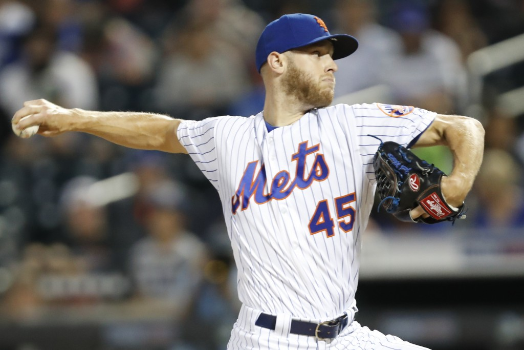 New York Mets starting pitcher Zack Wheeler (45) winds up during the first inning of a baseball game against the Los Angeles Dodgers, Sunday, Sept. 15...