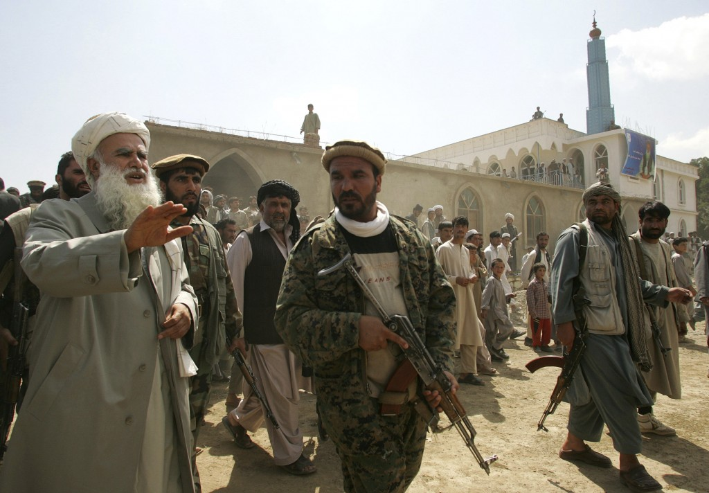 FILE - In this Sept. 14, 2005 file photo, Afghan candidate and former war commander Abdul Rasool Sayyaf, far left, campaigns for parliamentary electio...