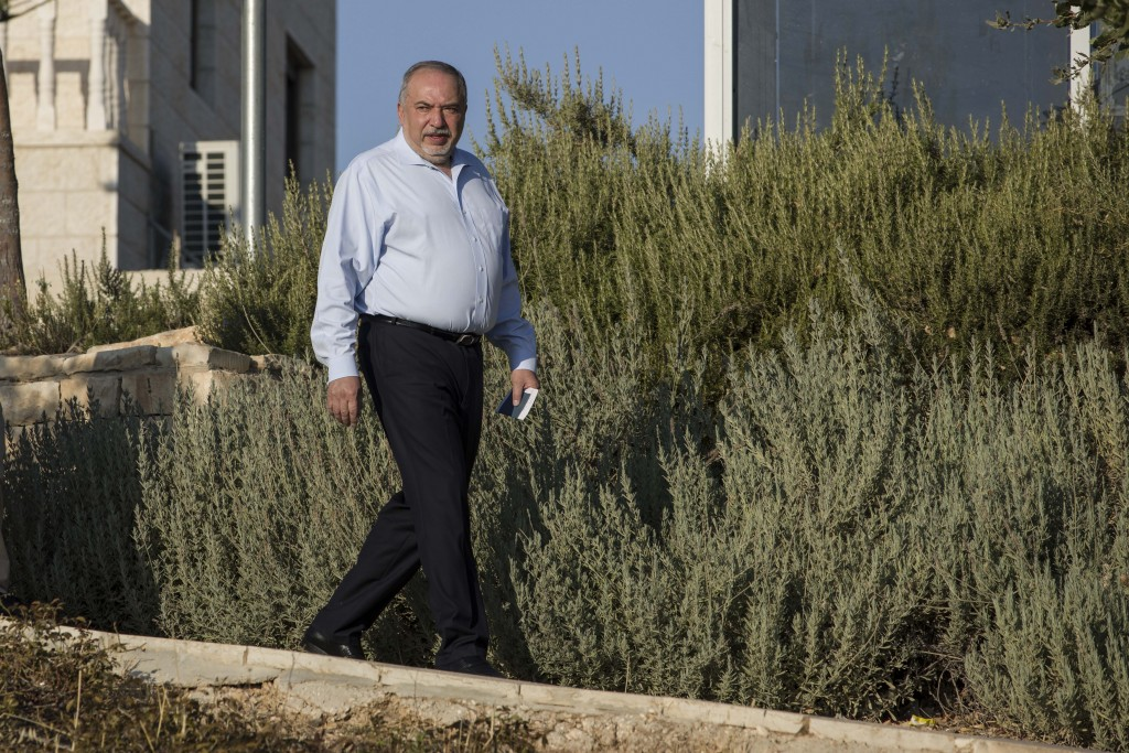 The leader of the Yisrael Beiteinu (Israel Our Home) right-wing nationalist party Avigdor Liberman arrives to votein the settlement of Nokdim, West Ba