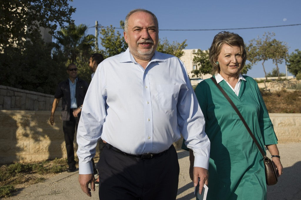 The leader of the Yisrael Beiteinu (Israel Our Home) right-wing nationalist party Avigdor Liberman come to vote with is wife Ella in the settlement of