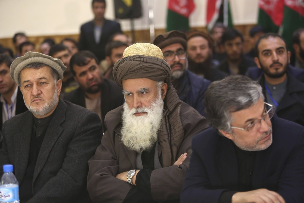 FILE - In this Dec. 18, 2015 file photo, former Afghan warlord Abdul Rasool Sayyaf, center, attends the inauguration of the Afghanistan Protection and