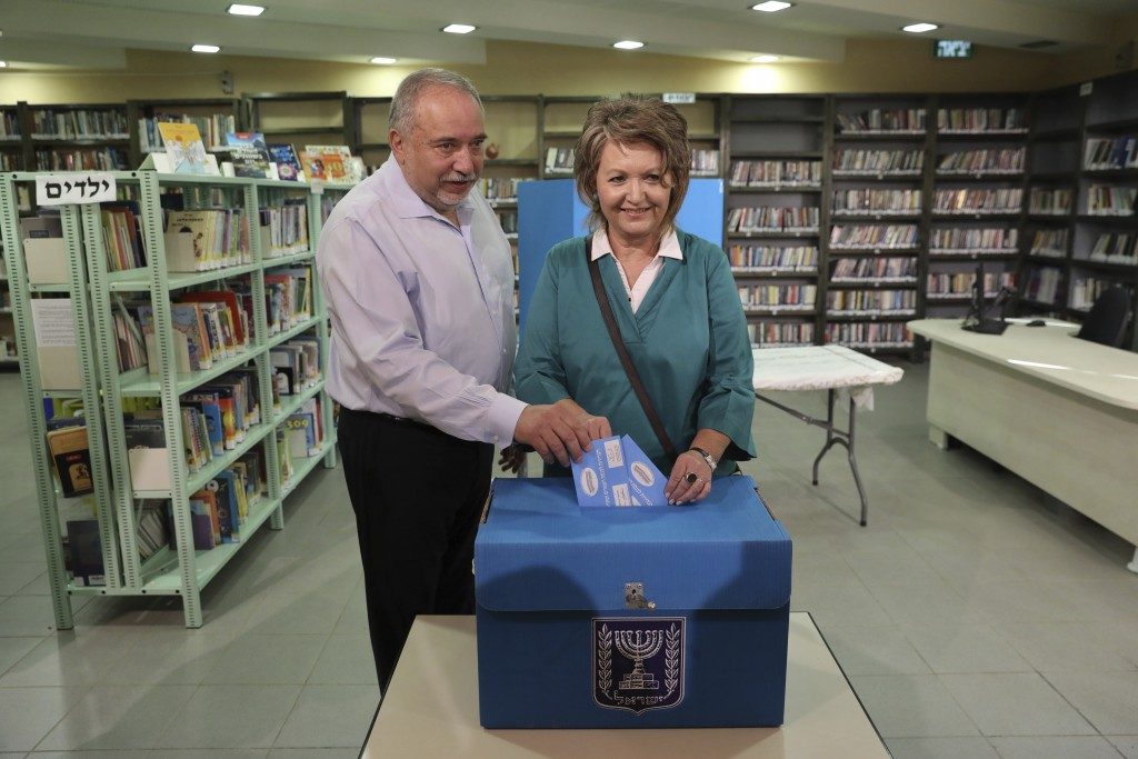 The leader of the Yisrael Beiteinu (Israel Our Home) right-wing nationalist party Avigdor Liberman votes with is wife Ella in the settlement of Nokdim