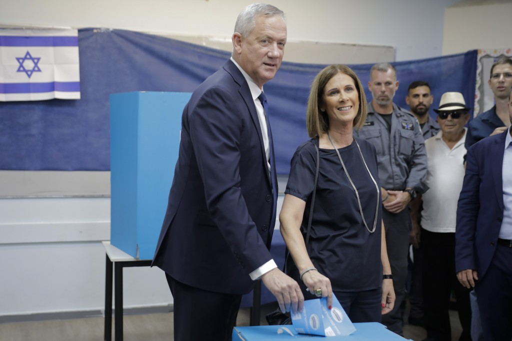 Blue and White party leader Benny Gantz and his wife Revital vote in Rosh Haayin, Israel, Tuesday, Sept. 17, 2019. Israelis began voting Tuesday in an...