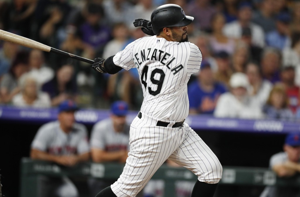Colorado Rockies' Antonio Senzatela connects for a single to drive in two runs off New York Mets starting pitcher Steven Matz in the fourth inning of