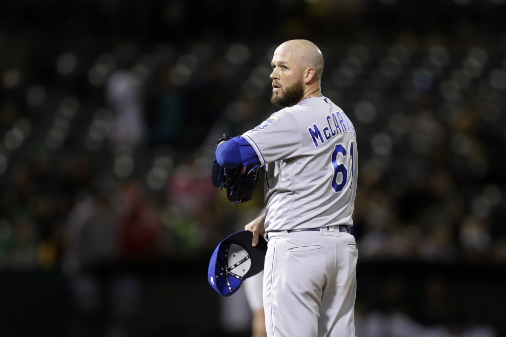 Kansas City Royals' Kevin McCarthy pauses in the eighth inning of a baseball game against the Oakland Athletics after giving up an RBI single to A's K...