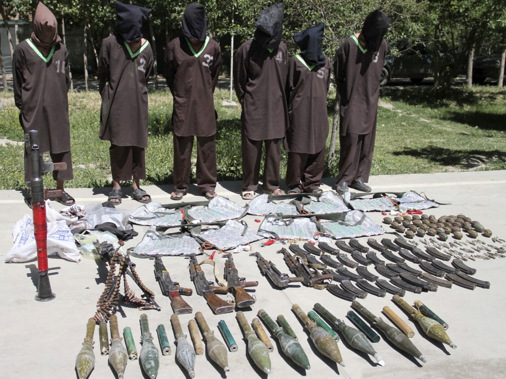 FILE - In this May, 30, 2013 file photo, insurgents suspected of being from the Haqqani network are presented to the media at the National Directorate