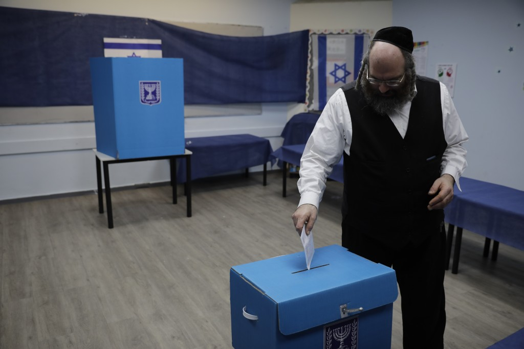 A man votes in Rosh Haayin, Israel, Tuesday, Sept. 17, 2019. Israelis began voting Tuesday in an unprecedented repeat election that will decide whethe...