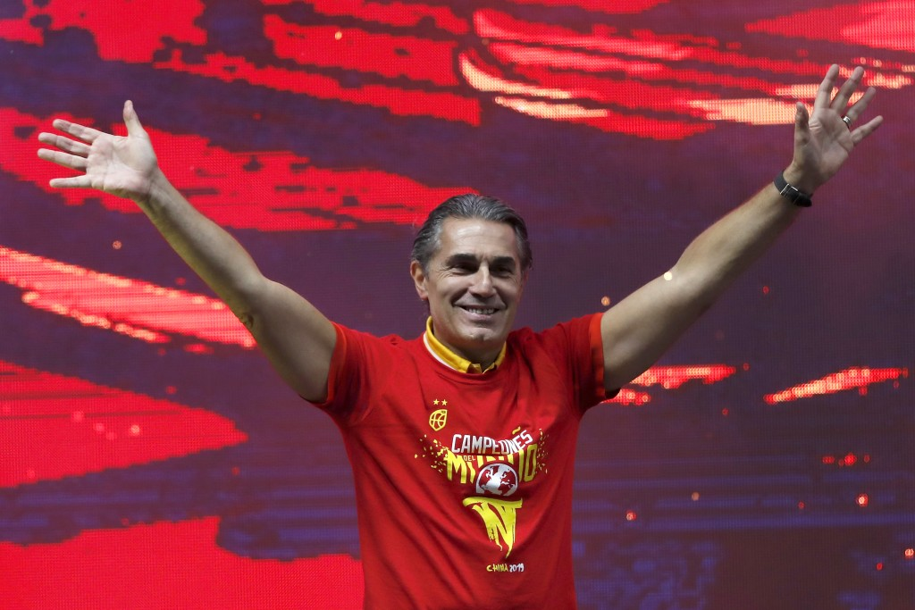 Head coach Sergio Scariolo of Spain celebrates with his players from Spain's national basketball team in front of fans in Madrid, Spain, Monday, Sept....