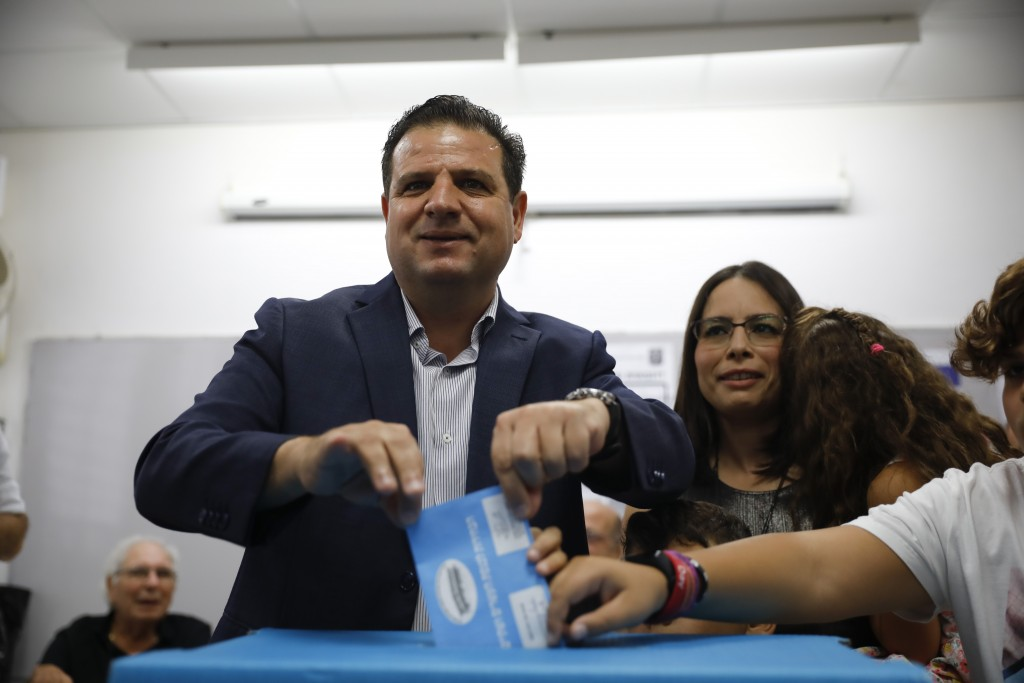 Israeli Arab politician Ayman Odeh casts his vote in Haifa, Israel, Tuesday, Sept. 17, 2019. Israelis began voting Tuesday in an unprecedented repeat ...