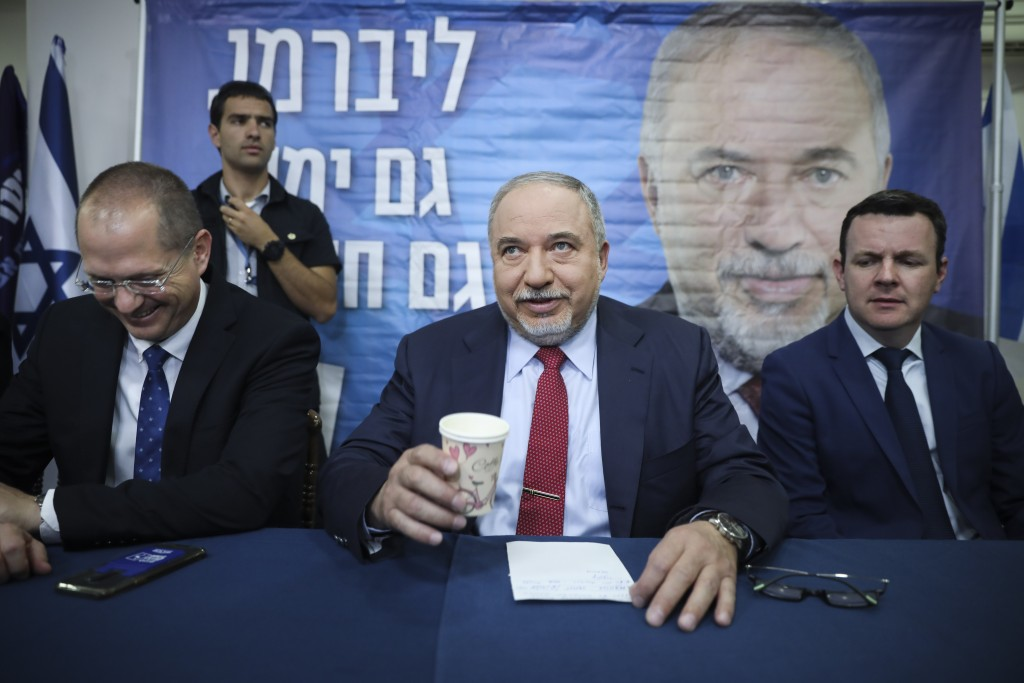 FILE - In this May 30, 2019 file photo, former Israeli Defense Minister and Yisrael Beiteinu party leader Avigdor Lieberman speaks at a press conferen...