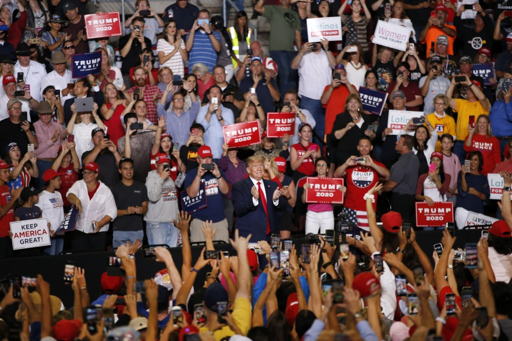 President Donald Trump is cheered by supporters upon his arrival to a campaign rally at the Santa Ana Star Center, Monday, Sept. 16, 2019, in Rio Ranc...
