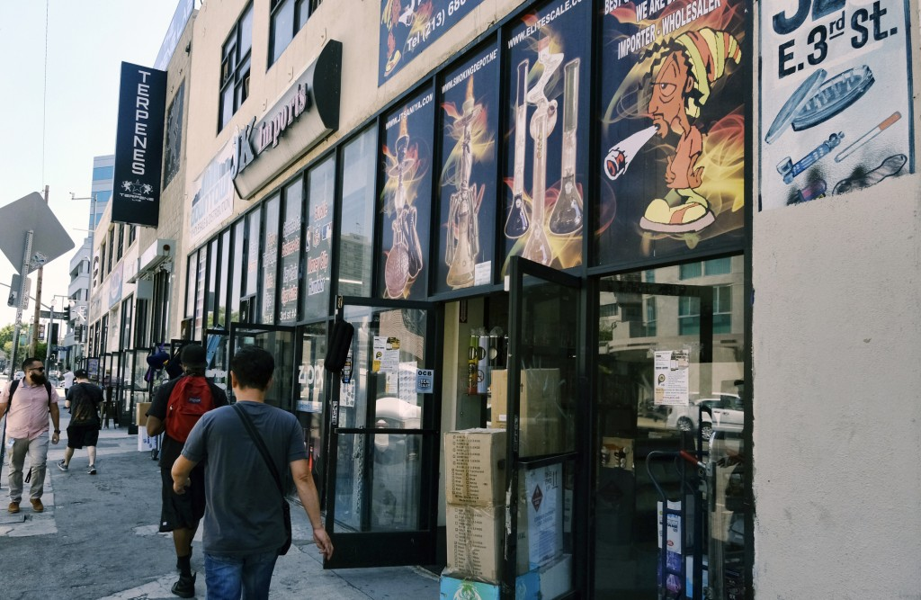 This Wednesday, Aug. 28, 2019, photo shows a bustling street lined with wholesale shops selling marijuana paraphernalia and vape supplies in downtown ...