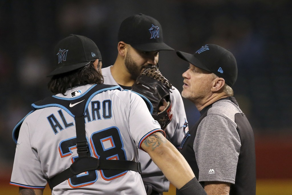 Miami Marlins pitching coach Mel Stottlemyre, right, visits Marlins starting pitcher Pablo Lopez, center, along with catcher Jorge Alfaro (38) during