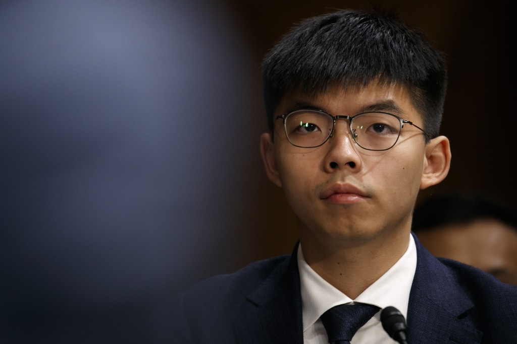 Hong Kong activist Joshua Wong, listens during a congressional hearing on the Hong Kong protests, Tuesday, Sept. 17, 2019, on Capitol Hill in Washingt...