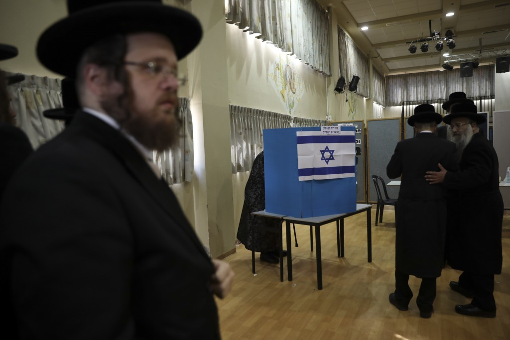 Ultra orthodox Jews wait for Rabbi Israel Hager to vote in Bnei Brak, Israel, Tuesday, Sept. 17, 2019. Israelis began voting Tuesday in an unprecedent...